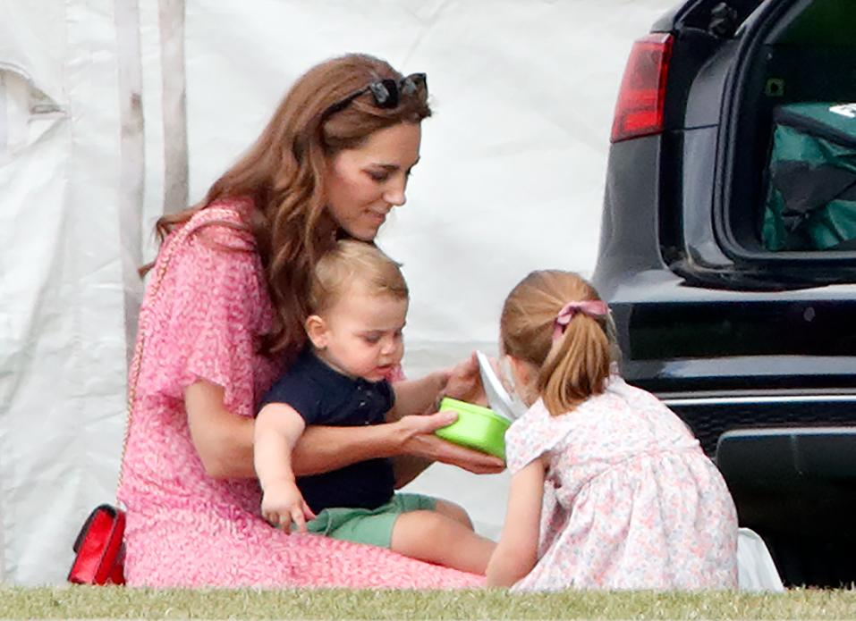 WOKINGHAM, UNITED KINGDOM - JULY 10: (EMBARGOED FOR PUBLICATION IN UK NEWSPAPERS UNTIL 24 HOURS AFTER CREATE DATE AND TIME) Catherine, Duchess of Cambridge, Prince Louis of Cambridge and Princess Charlotte of Cambridge attend the King Power Royal Charity Polo Match, in which Prince William, Duke of Cambridge and Prince Harry, Duke of Sussex were competing for the Khun Vichai Srivaddhanaprabha Memorial Polo Trophy at Billingbear Polo Club on July 10, 2019 in Wokingham, England. (Photo by Max Mumby/Indigo/Getty Images)