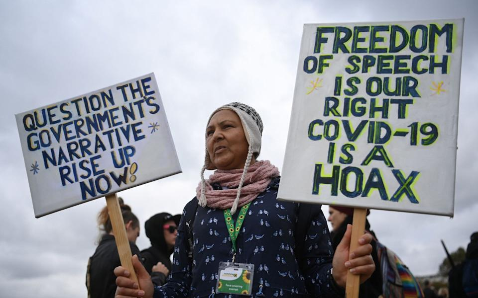 Protesters attend a rally against vaccinations and coronavirus - NEIL HALL/EPA-EFE/Shutterstock