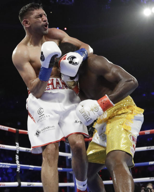 England's Amir Khan reacts to a low blow by Terence Crawford during the sixth round of a WBO world welterweight championship boxing match Sunday, April 21, 2019, in New York. Crawford won the fight when Kahn could not continue. (AP Photo/Frank Franklin II)