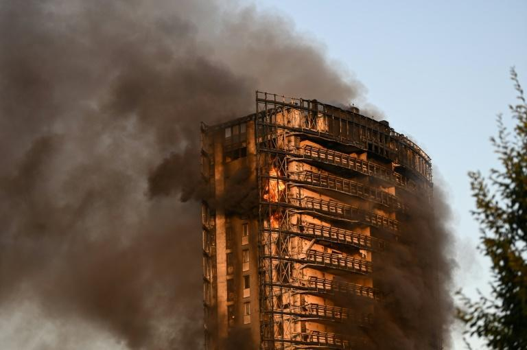 The fire started on the upper floors (AFP/Piero CRUCIATTI)