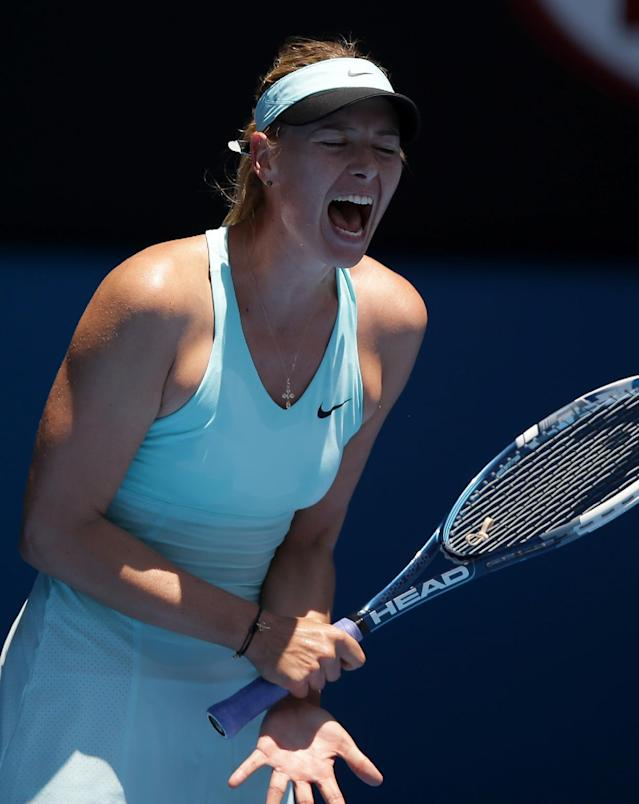 Maria Sharapova of Russia reacts during her second round match against Karin Knapp of Italy at the Australian Open tennis championship in Melbourne, Australia, Thursday, Jan. 16, 2014.(AP Photo/Aaron Favila)