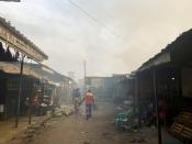 FILE PHOTO: Smoke rises over the neighboring houses after the fire tore through an overcrowded New-Bell central prison in the port city of Douala