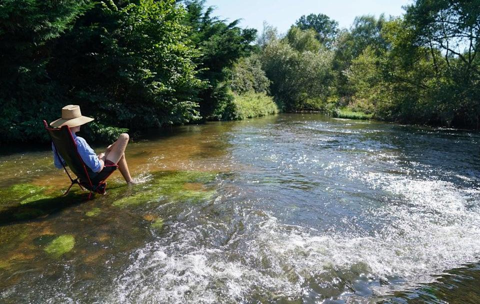Cooling off in the river Wey in Tilford, Surrey (Andrew Matthews/PA) (PA Wire)