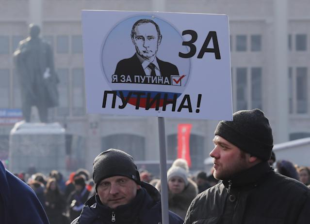 "<p>People carry a placard reading, ""We are for Putin!"" as they walk after a rally to support Russian President Vladimir Putin in the upcoming presidential election at Luzhniki Stadium in Moscow, Russia, March 3, 2018. (Photo: Maxim Shemetov/Reuters) </p>"