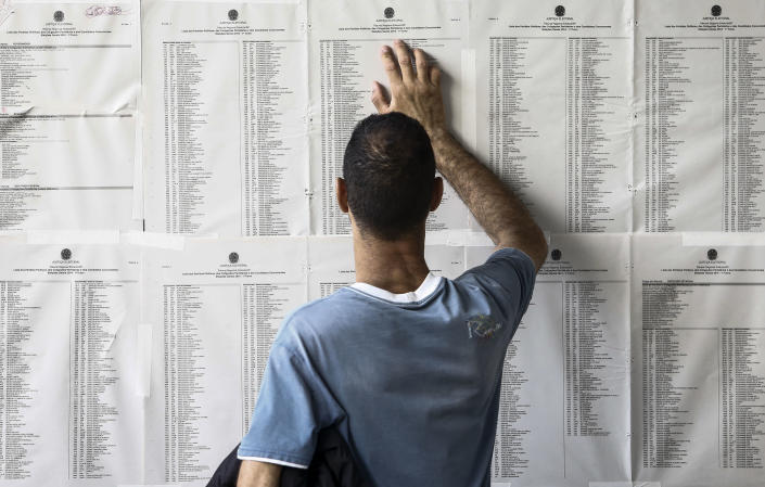 A man searches where to vote at a polling station in Sao Paulo, Brazil on October 5, 2014, during general elections (AFP Photo/Miguel Schincariol)