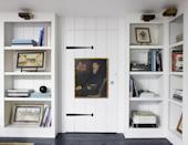 """<p>Atlanta-based designer <a href=""""https://amymorrisinteriors.com/"""" rel=""""nofollow noopener"""" target=""""_blank"""" data-ylk=""""slk:Amy Morris"""" class=""""link rapid-noclick-resp"""">Amy Morris</a> transformed the attic of a <a href=""""https://www.veranda.com/decorating-ideas/a28577679/amy-morris-atlanta-house-tour/"""" rel=""""nofollow noopener"""" target=""""_blank"""" data-ylk=""""slk:100-year-old Tudor manse"""" class=""""link rapid-noclick-resp"""">100-year-old Tudor manse </a>into a quaint library. The series of hand-rubbed brass reading lights up the bookcases filled with literary classics and stunning photography. The portrait is by early-20th-century artist Trevor James. </p>"""