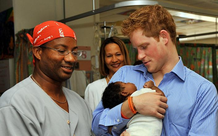 Prince Harry visits Barbados in 2010 - PA