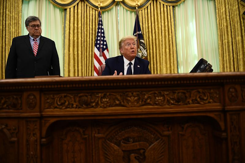 US President Donald Trump speaks as US Attorney General William Barr listens before signing an executive order on social-media companies in the Oval Office of the White House on May, 28, 2020. (Photo by Brendan Smialowski / AFP) (Photo by BRENDAN SMIALOWSKI/AFP via Getty Images)