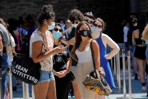 PHOTO: Students wear protective masks as they wait in line at a COVID-19 testing site set for returning students, faculty and staff on the main New York University (NYU) campus in New York City, Aug. 18, 2020. (Mike Segar/Reuters)