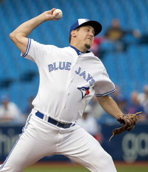 Toronto Blue Jays starting pitcher Derek Law throws against the Los Angeles Angels during first-inning baseball game action in Toronto, Monday, June 17, 2019. (Fred Thornhill/The Canadian Press via AP)