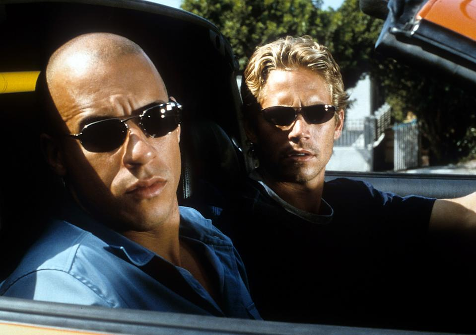 Vin Diesel and Paul Walker looking from car in a scene from the film 'The Fast And The Furious', 2001. (Photo by Universal/Getty Images)