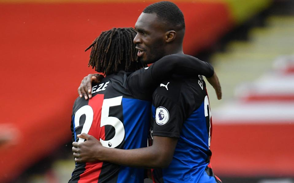 Christian Benteke celebrates with Eze after making it 1-0 to Crystal Palace early on - AFP
