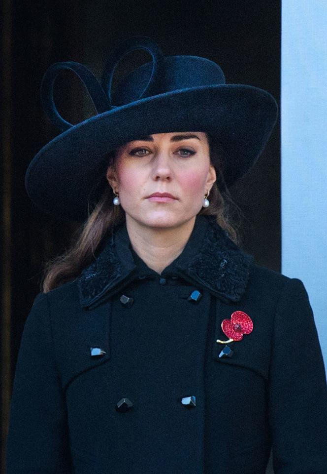 In her second-ever Remembrance Day as a royal, Kate, who has always been a fan of the royal rewear, wore the same black jacket with a textured collar she would go on to wear again in 2016.  This time around though, Kate decided to wear her hair down and opt for a larger black hat — which she re-wore in 2017.