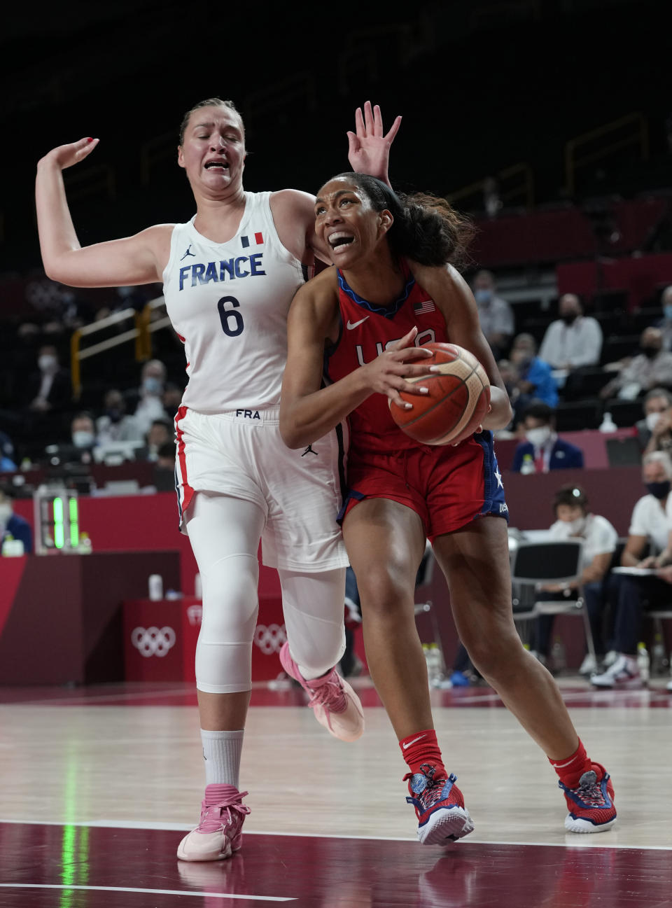 United States' A'Ja Wilson (9), right, drives around of France's Alexia Chartereau (6) during women's basketball preliminary round game at the 2020 Summer Olympics, Monday, Aug. 2, 2021, in Saitama, Japan. (AP Photo/Eric Gay)