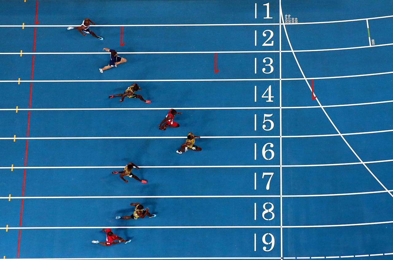 MOSCOW, RUSSIA - AUGUST 11: (top to bottom) Mike Rodgers of the United States, Nesta Carter of Jamaica, Kemar Bailey-Cole of Jamaica, Usain Bolt of Jamaica, Justin Gatlin of the United States, Nickel Ashmeade of Jamaica, Christophe Lemaitre of France and James Dasaolu of Great Britain compete in the Men's 100 metres Final during Day Two of the 14th IAAF World Athletics Championships Moscow 2013 at Luzhniki Stadium on August 11, 2013 in Moscow, Russia. (Photo by Julian Finney/Getty Images)