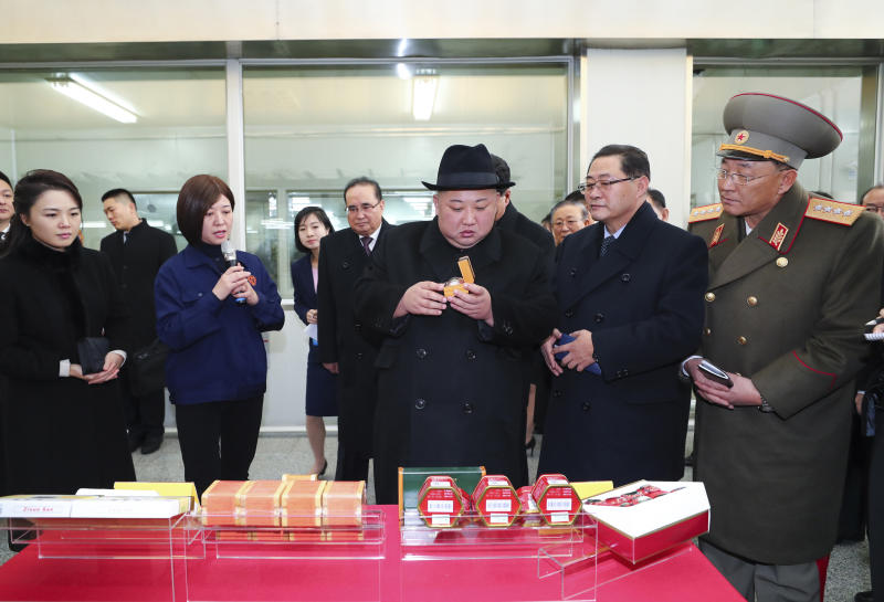 In this Wednesday, Jan. 9, 2019, photo released Thursday, Jan. 10, 2019, by China's Xinhua News Agency, North Korean leader Kim Jong Un, center, in hat, visits a facility for Chinese traditional medicine maker Tong Ren Tang in Beijing. A special train believed to be carrying Kim Jong Un departed Beijing on Wednesday after a two-day visit by the North Korean leader to the Chinese capital. (Xie Huanchi/Xinhua via AP)