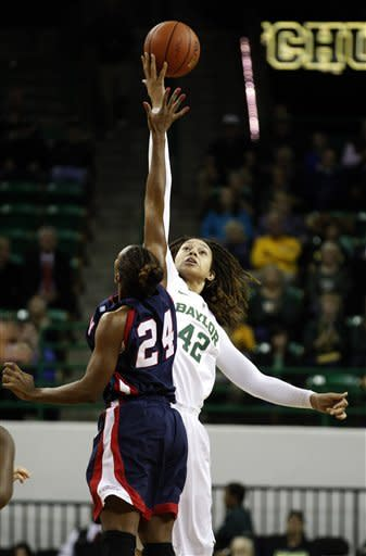 Baylor's Brittney Griner (42) jumps for the ball against Liberty's Jasmine Gardner (24) during the first half of an NCAA college basketball game Friday, Nov. 23, 2012, in Waco, Texas. (AP Photo/LM Otero)
