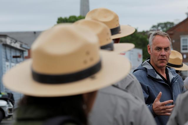Interior Secretary Ryan Zinke talks to National Park Service rangers, while traveling for his National Monuments Review process, in Boston last June. (Photo: Brian Snyder/Reuters)