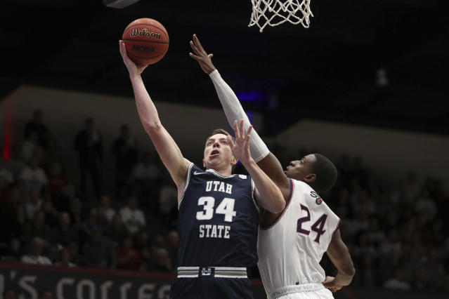 Utah State forward Justin Bean (34) shoots next to Saint Mary's forward Malik Fitts (24) during the first half of an NCAA college basketball game in Moraga, Calif., Friday, Nov. 29, 2019. (AP Photo/Jed Jacobsohn)