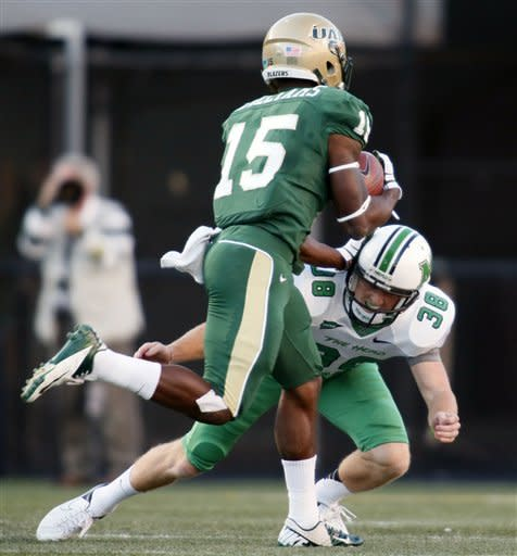 UAB wide receiver Jackie Williams (15) gets around Marshall punter Tyler Williams for a long touchdown rerun on a punt in the first half of an NCAA college football game at Legion Field in Birmingham, Ala., Saturday, Nov. 10, 2012. (AP Photo/Hal Yeager)