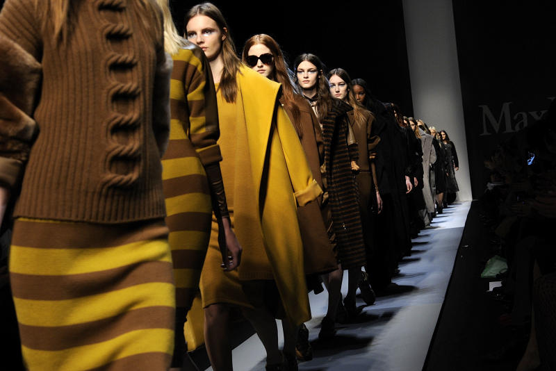 Models wear creations for Max Mara women's Fall-Winter 2013-14 collection, part of the Milan Fashion Week, unveiled in Milan, Italy, Thursday, Feb. 21, 2013. (AP Photo/Giuseppe Aresu)