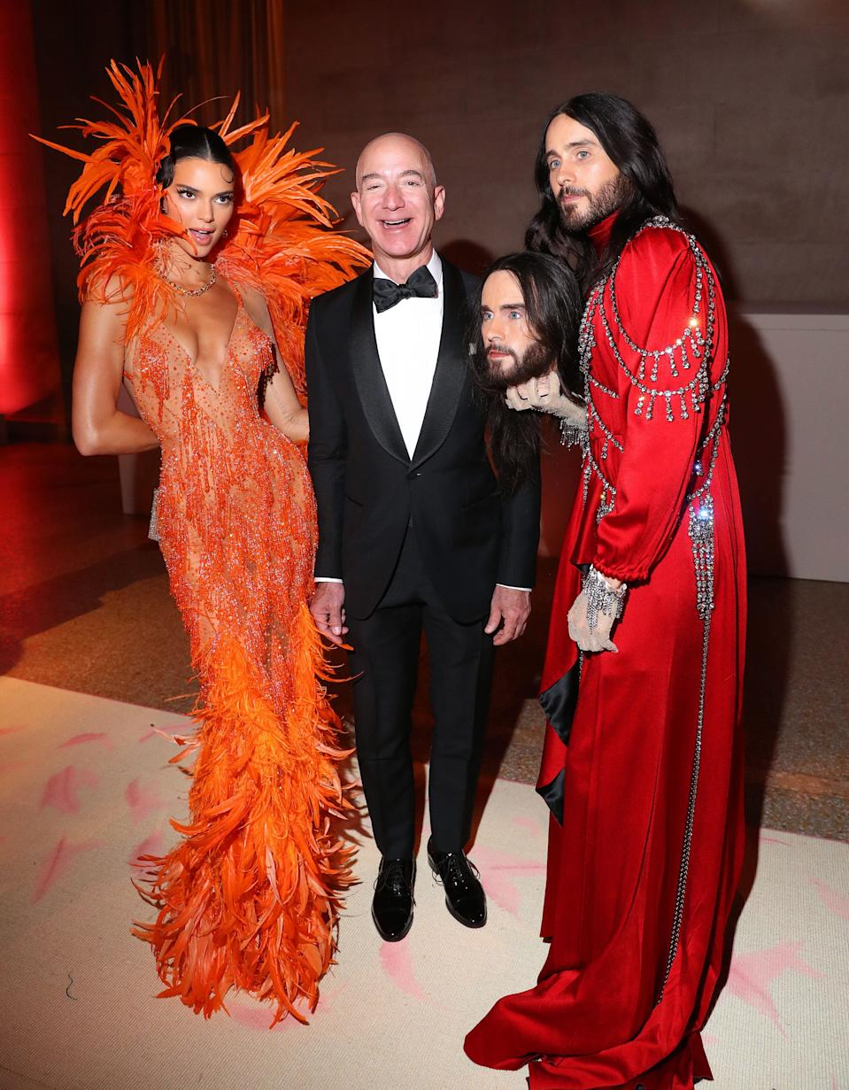 Jared Leto poses with Kendall Jenner, Jeff Bezos and a replica of his own head at the 2019 Met Gala. Image: Getty