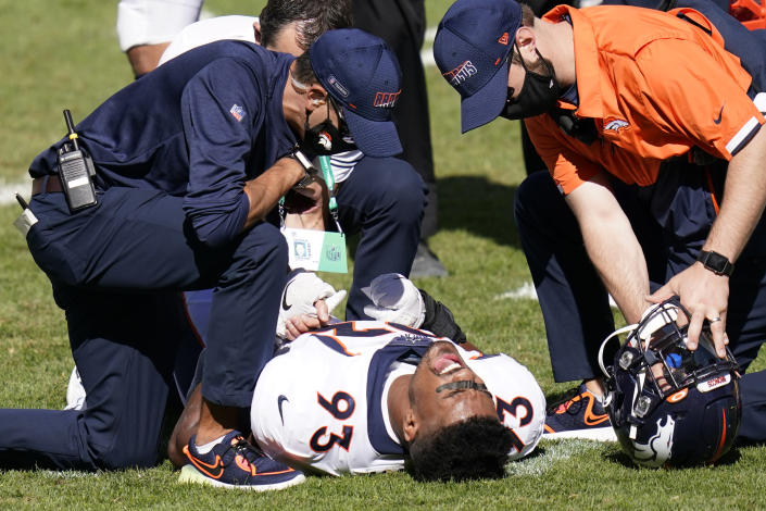 Denver Broncos defensive end Dre'Mont Jones (93) is tended to by team trainers after being injured during the second half of an NFL football game against the Pittsburgh Steelers, Sunday, Sept. 20, 2020, in Pittsburgh. (AP Photo/Keith Srakocic)