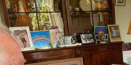 A picture which looks to be of Prince George is on his sideboard. (Clarence House/Global)