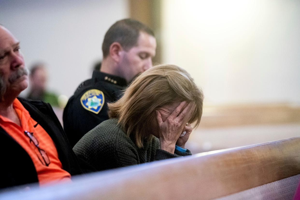 Lauren Gill,the town manager for Paradise, California, cries during a vigil for Camp Fire victims on Sunday at the First Christian Church of Chico. (Photo: (AP Photo/Noah Berger, Pool))
