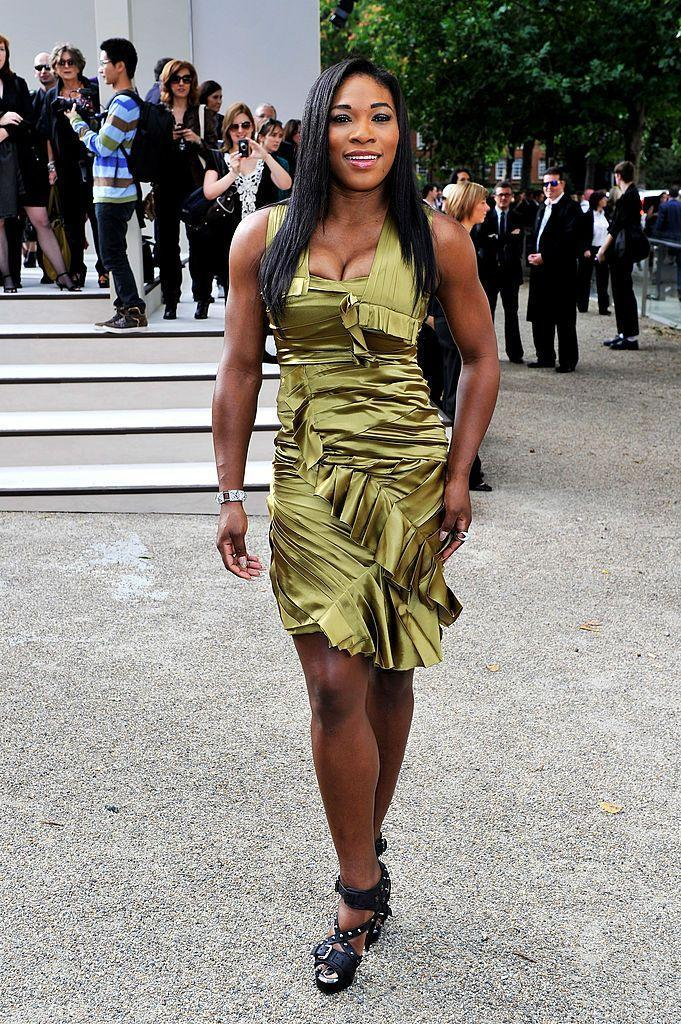 <p>Williams glowed in a metallic green ruffled dress for the fashion show.</p>