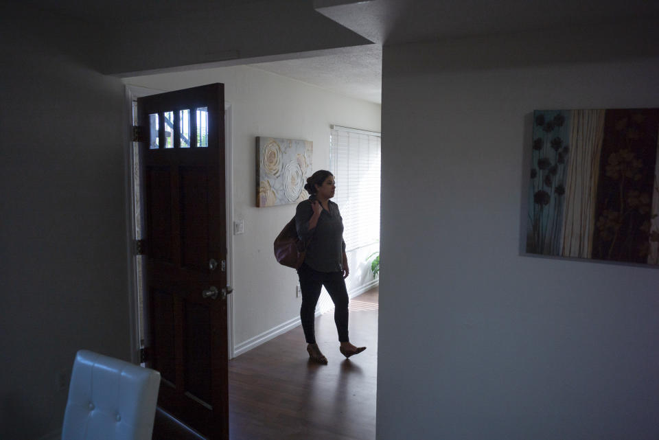 In this June 20, 2019 photo Irene Scully tours an apartment for rent in Escondido, Calif. (AP Photo/Gregory Bull)