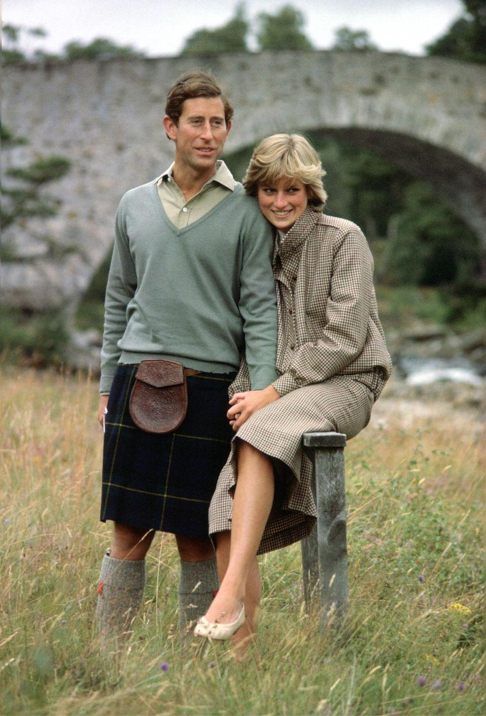 <p>In a tweed suit by Bill Pashley and cream flats from a Chelsea cobbler by the River Dee in Balmoral. </p>