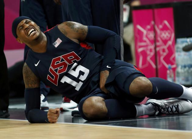 Carmelo Anthony grimaces after being punched in the groin against Argentina. (Reuters)