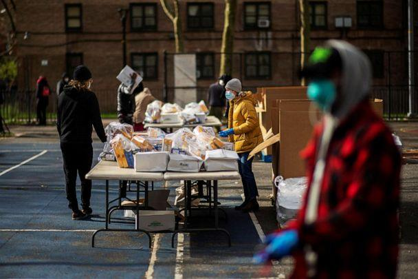 PHOTO: Workers organize food to be donated by City Harvest Mobile Market Food Distribution Center, during the outbreak of the coronavirus disease in the Brooklyn borough of New York, April 15, 2020. (Eduardo Munoz/Reuters)