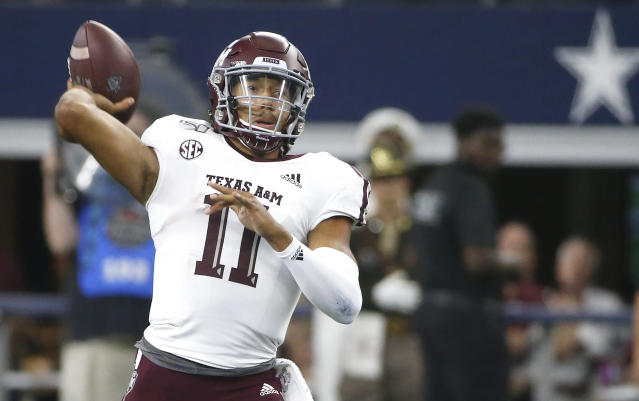 Texas A&M quarterback Kellen Mond (11) throws down field against Arkansas during the first half of an NCAA college football game Saturday, Sept. 28, 2019, in Arlington, Texas. (AP Photo/Ron Jenkins)