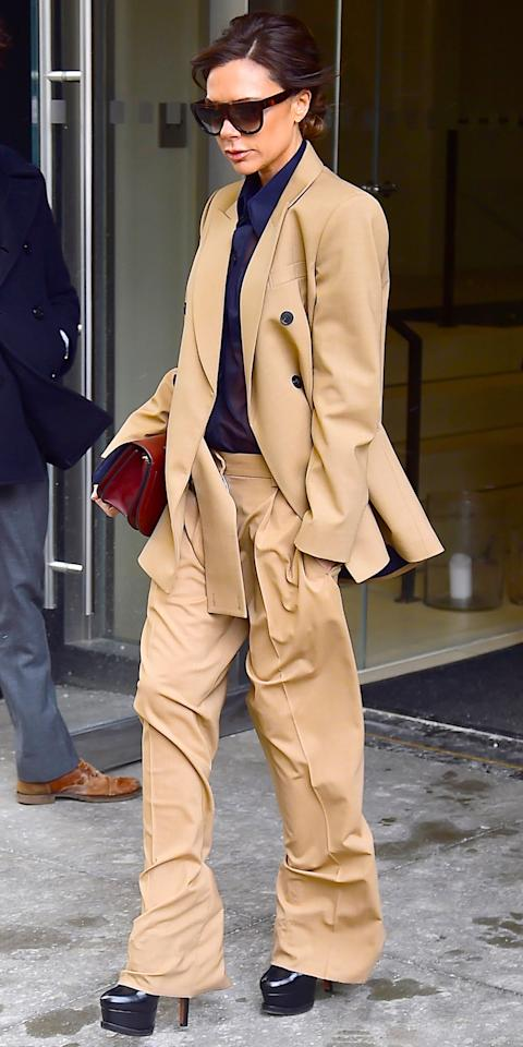 <p>Snow and ice can't slow down Victoria Beckham. The fashionista stepped out in N.Y.C. the day after a blizzard in a pair of sky-high platform stilettos. She paired the navy pumps with a matching blouse and camel-colored suiting separates.</p>