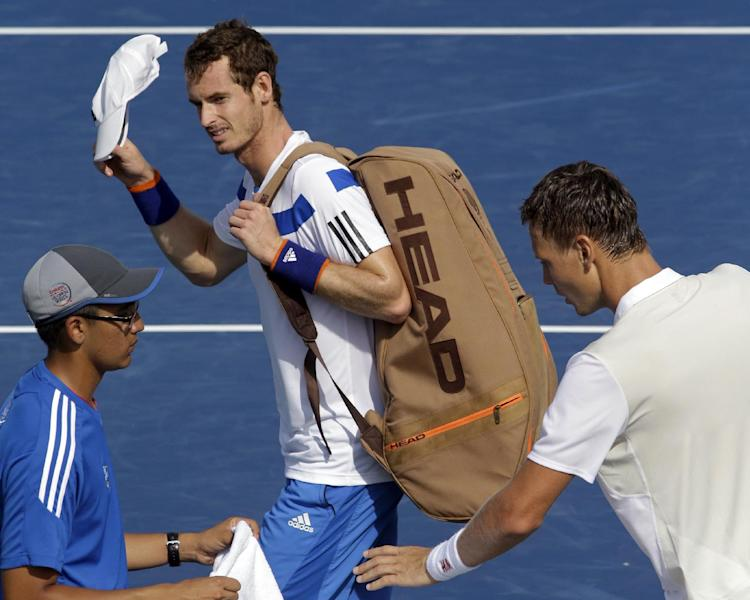 Andy Murray, from Great Britain, walks off court after losing 6-3, 6-4, to Tomas Berdych, right, from the Czech Republic, in a quarterfinal match at the Western & Southern Open tennis tournament, Friday, Aug. 16, 2013, in Mason, Ohio. (AP Photo/Al Behrman)