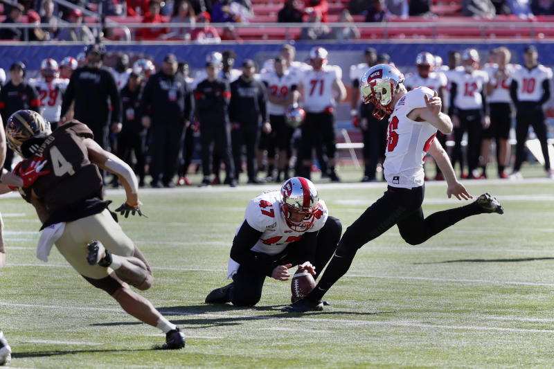 Western Kentucky place kicker Cory Munson, right, kicks a field goal from the hold of John Haggerty (47) while Western Michigan cornerback Patrick Lupro (4) applies pressure during the first half of the NCAA First Responder Bowl college football game in Dallas, Monday, Dec. 30, 2019. (AP Photo/Roger Steinman)