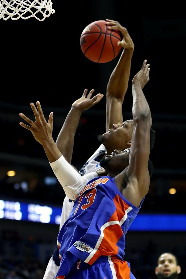 <p>Tre'Shawn Thurman #0 of the Nevada Wolf Pack battles for the ball with Kevarrius Hayes #13 of the Florida Gators in the second half during the first round of the 2019 NCAA Men's Basketball Tournament at Wells Fargo Arena on March 21, 2019 in Des Moines, Iowa. </p>