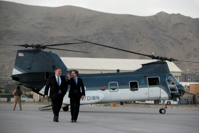 US Secretary of State Mike Pompeo (L) walks from a helicopter with his ambassador to Afghanistan John Bass, in Kabul on June 25, 2019 -- about six months before Bass finished his term in the country
