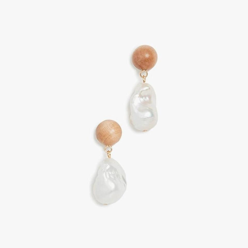 """Pair these Sophie Monet pearl earrings with white tees, dresses, and even swimsuits this Labor Day Weekend and beyond. $225, SHOPBOP. <a href=""""https://www.shopbop.com/baroque-wood-drop-earrings-sophie/vp/v=1/1537745624.htm?folderID=13594&fm=other-shopbysize-viewall&os=false&colorId=17AC9&ref_=SB_PLP_NB_16"""" rel=""""nofollow noopener"""" target=""""_blank"""" data-ylk=""""slk:Get it now!"""" class=""""link rapid-noclick-resp"""">Get it now!</a>"""