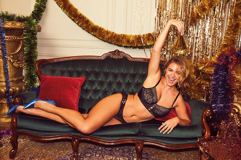 A photo of Katie Muirhead wearing a black matching bra and underwear in Bras N Things' holiday campaign.