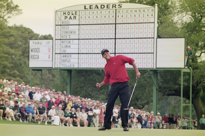 Tiger Woods celebrates after sinking a four-foot putt to win the Masters on April 13, 1997.