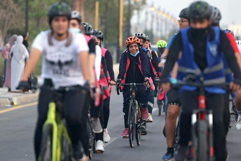 """Women in the """"Courage"""" mixed-gender cycling club go for a ride in Jeddah, Saudi Arabia (AFP/Fayez Nureldine)"""