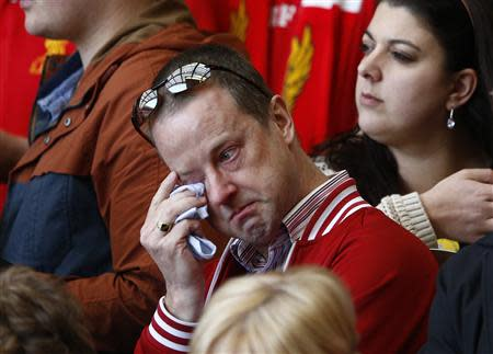 A man weeps during a memorial service to mark the 25th anniversary of the Hillsborough disaster at Anfield in Liverpool, northern England April 15, 2014. REUTERS/Darren Staples