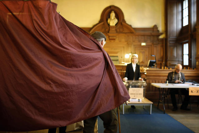 <p>A man leaves a voting booth after casting his ballot in the second round of the French presidential election in Paris, May 7, 2017. (Laurent Cipriani/AP) </p>
