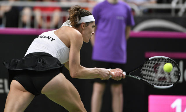 Germany's Andrea Petkovic returns a shot against Latvia's Jelena Ostapenko during their play-off round Fed Cup tennis match in Riga, Latvia, Friday, April 19, 2019. (AP Photo/Roman Koksarov)