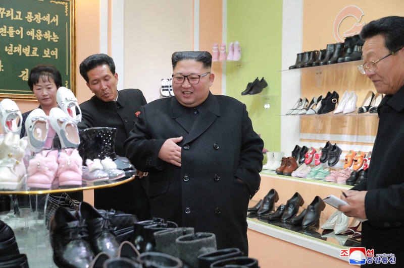 """In this undated photo released Monday, Dec. 3, 2018, by the North Korean government, North Korean leader Kim Jong Un, center, visits the Wonsan Shoes Factory in Gangwon, North Korea. South Korea's President Moon Jae-in says U.S. President Donald Trump told him he has a """"very friendly view"""" of North Korean leader Kim Jong Un and wants to grant his wishes if he denuclearizes. Independent journalists were not given access to cover the event depicted in this image distributed by the North Korean government. The content of this image is as provided and cannot be independently verified. Korean language watermark on image as provided by source reads: """"KCNA"""" which is the abbreviation for Korean Central News Agency. (Korean Central News Agency/Korea News Service via AP)"""