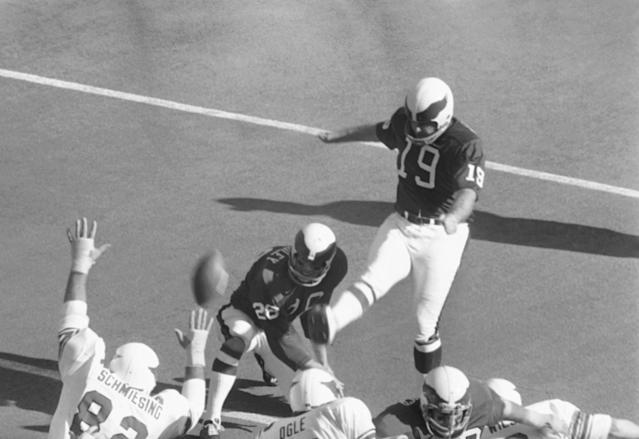 FILE - In this Nov. 22, 1971 file photo, Philadelphia Eagles Tom Dempsey (19) kicks a point after a touch down during the first period on his way to 13 points, during an NFL football game against the St. Louis Cardinals in St. Louis, Mo. Dempsey, who played in the NFL despite being born without toes on his kicking foot and made a record 63-yard field goal, died late Saturday, April 4, 2020, in New Orleans while struggling with complications from the new coronavirus, his daughter said. He was 73 years old. (AP Photo/File)