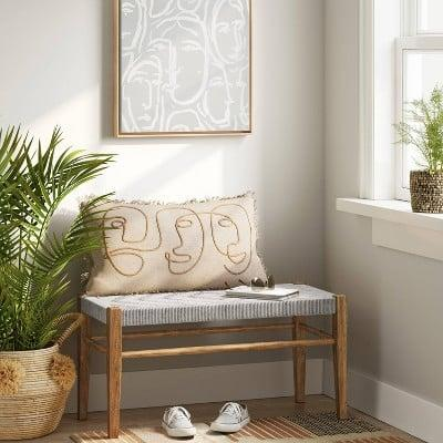 <p>No one will miss this <span>Lumarco Woven Bench</span> ($100) when they come over.</p>